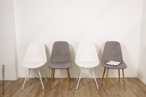 Multiple Loft Style Empty Chairs Standing In Row On Wooden Floor,  Counseloru0027s Seat Clipboard U0026