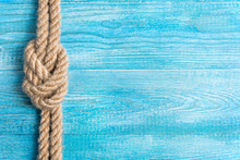 Rope, Knot And Background Wood