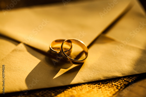 Fotografie, Tablou  Wedding golden rings. Wedding table.