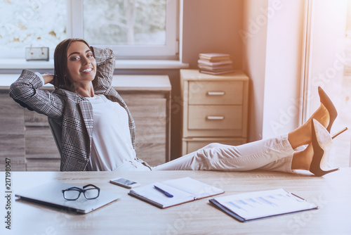 Fotografie, Obraz  Pretty Business Lady Smiling and Sitting in Office