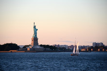 Sunset Over Statue Of Liberty, New York