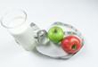fresh apple with measuring tape. fresh tomato. sour milk product isolated on white background