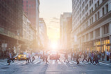 Fototapeta Nowy Jork - Anonymous crowd of people cross the intersection on a busy New York City street in Manhattan with sunlight background