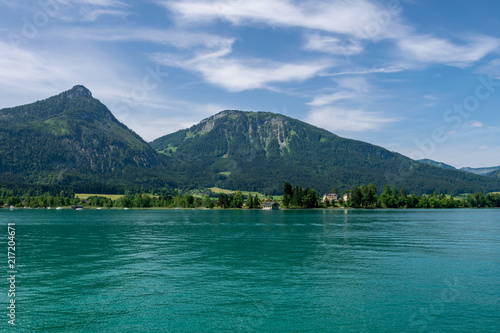Poster Bergen Lake called Wolfgangsee in Austria with Mountains in the Background and Clouds on the Sky