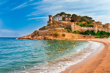 Sea landscape Badia bay in Tossa de Mar in Girona, Catalonia, Spain near of Barcelona. Ancient medieval castle with nice sand beach and clear blue water. Famous tourist destination in Costa Brava