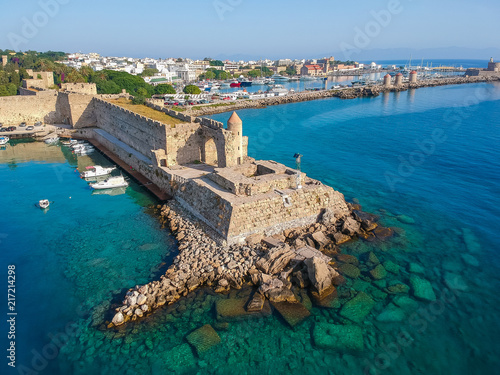Aerial birds eye view drone photo of Rhodes city island, Dodecanese, Greece. Panorama with Mandraki port, lagoon and clear blue water. Famous tourist destination in South Europe