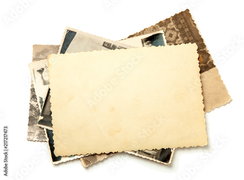 Obraz Stack old photos isolated on white background. Mock-up blank paper. Postcard rumpled and dirty vintage - fototapety do salonu