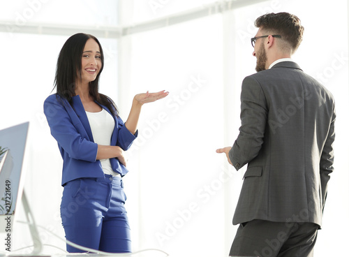 Happy laughing young businesswoman sharing a joke with a male co Canvas Print