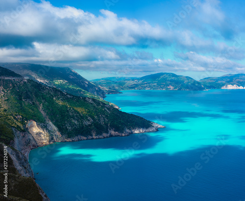 Picturesque rocky coastline on Kefalonia island. Amazing landscape with cloudscape and shadows on sea surface. Greece