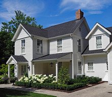 White Clapboard House With Gable And Portico Entrance