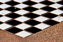 Tiles Chess Board Inlaid On A Concrete Table