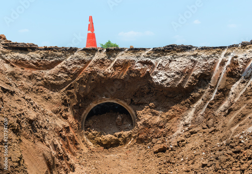 Valokuva Concrete Drainage Pipe and orange traffic cone on a Construction Site