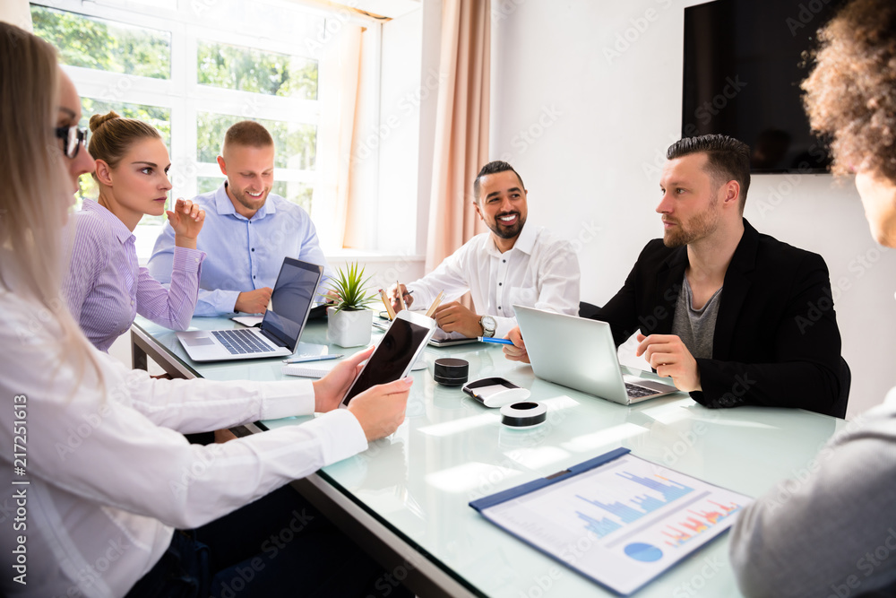 Fototapeta Group Of Businesspeople Sitting In Office