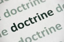Word Doctrine Printed On Paper Macro