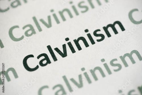 Fotografering  word Calvinism  printed on paper macro