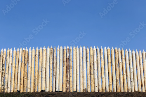 Photo  wooden palisade