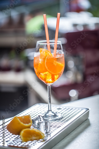 Poster Cocktail Aperol spritz drink on bar counter in pub or restaurant
