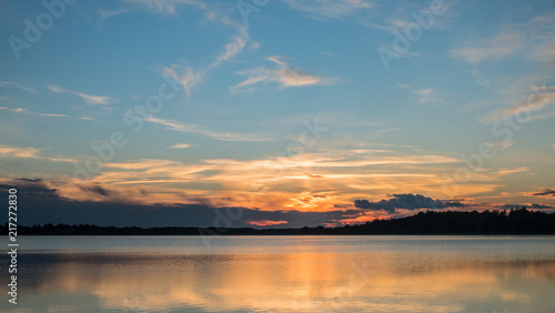 Papiers peints Morning Glory Amazing colorful lake sunset landscape with fantastic colors in the sky and reflection in the water. Beauty world natural outdoors travel background