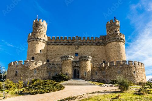 Facade of a medieval castle palace under a blue sky (Manzanares el Real, Spain) Fotobehang