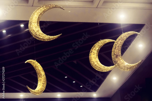 Half Moon Decorations Hanging From The