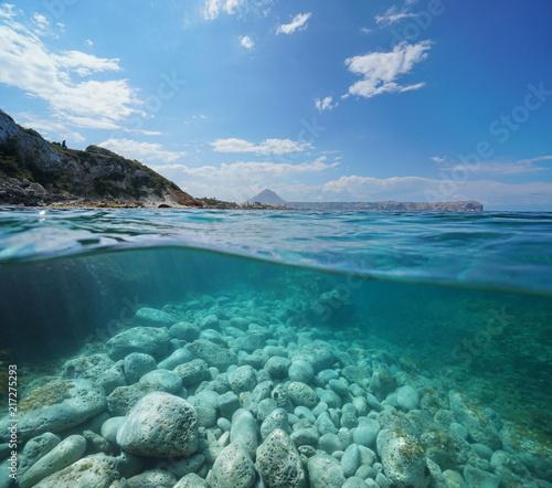 Fotografie, Obraz  Coastline near Javea town with the cape San Antonio in background and rocks unde