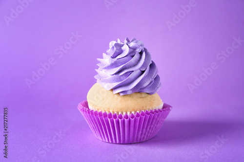 Delicious birthday cupcake on color background Poster