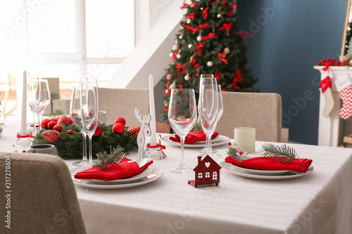 Stylish table setting with Christmas decorations