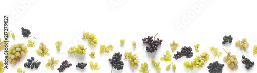 Fényképezés  A banner made of black and green grapes isolated on a white background
