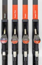 Close Up Of Four Gas Pump Nozz...