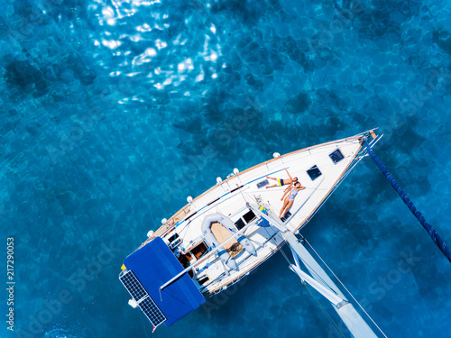 Foto Aerial view to Yacht in deep blue sea. Drone photography
