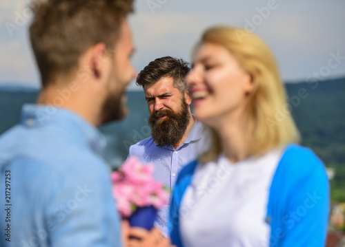 Couple in love happy dating, jealous bearded man watching wife cheating him with lover Canvas Print