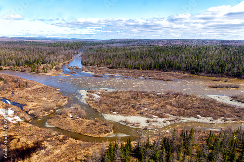 Tuinposter Cappuccino Northern landscape. Spilling of the taiga river. Impenetrable forest and swamp