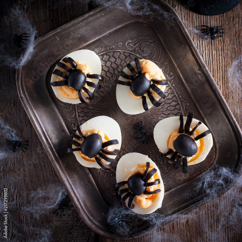 The idea for decorating a table for Halloween: stuffed eggs with spiders, top view