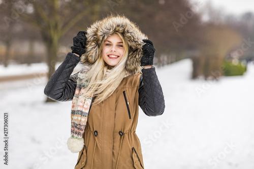 Portrait of fashionable teenage girl in winter