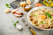 Traditional Italian Pasta, Spaghetti Carbonara With Bacon, Creamy Sauce, Parmesan Cheese, Egg Yolk And Fresh Basil Leaves Grey Stone Background Copy Space