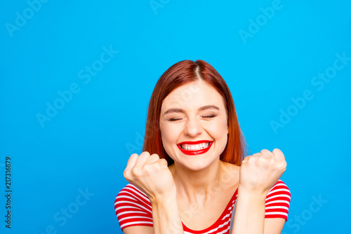 Fotografiet Portrait of nice vivid girlish red straight-haired happy smiling