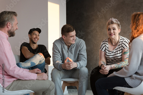 Vászonkép Teenagers laughing during a group counseling session for youth
