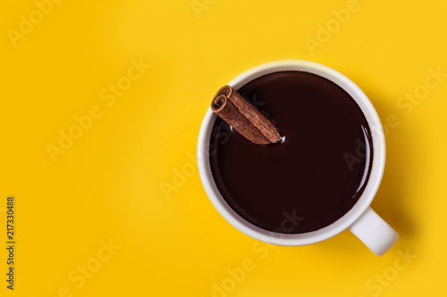 Hot chocolate cup with cinnamon. Warming winter or autumn drink concept