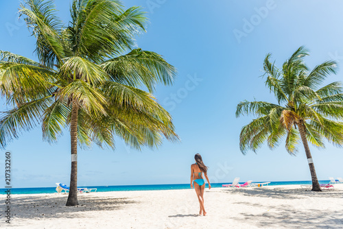 Caribbean beach in Barbados, bikini woman relaxing on Dover beach summer travel destination Poster