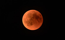 A Full Moon Or Blood Moon During A Complete Lunar Eclipse In A Black Night Sky With Stars