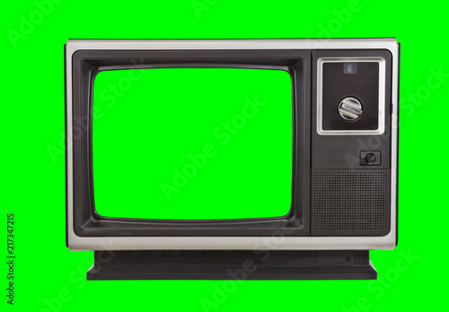 Photo Vintage 1970s television with chroma green background and screen.