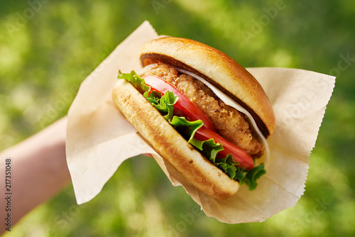 woman holding crispy chicken sandwich from first person view