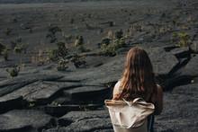 Woman On Volcanic Rock