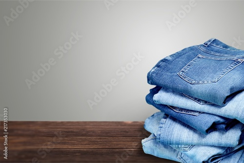 Fotografia  Stack of jeans isolated on white background