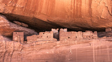 Historic Native Anasazi Cave Dwellings Built In A Sandstone Cliff In The Canyon De Chelly, Chinle, Arizona, USA.
