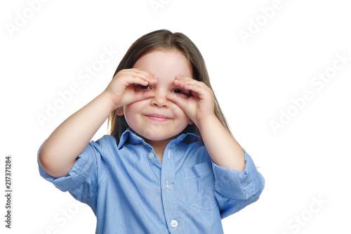 Fotografija  Funny little girl making fake comic glasses with her fingers