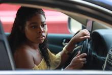 Ethnic Woman Driving Car Carefully