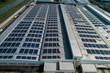 aerial view of factory roof with solar panels