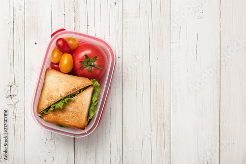 Papiers peints Assortiment Lunch box with sandwich and tomatoes