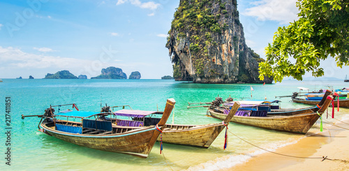 Amazing view of beautiful beach with longtale boats. Location: Railay beach, Krabi, Thailand, Andaman Sea. Artistic picture. Beauty world. Panorama